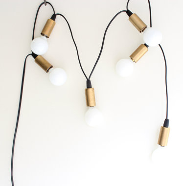 13 Black and white gift ideas from Etsy: Brass Cup Candelabra String Lights from JonesCountyRoad